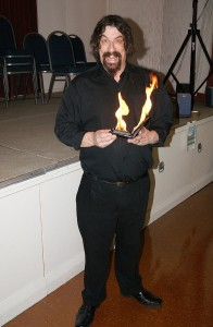Magician Jonathan Usher with money burning a hole in his pocket