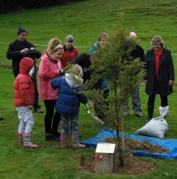 Children planting commemorative tree